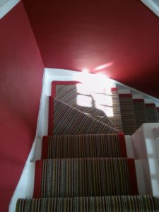 Customised Red Striped Carpet Staircase And Landing